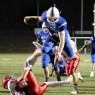 LeominsterÕs Anthony Dandini leaps into the end zone to score a touchdown against St. JohnÕs. SENTINEL & ENTERPRISE / SCOTT LAPRADE