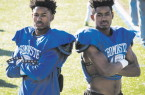 Leominster High football players and twin brothers Kyle, left, and Keith Jackson pose during WednesdayÕs practice at Doyle Field.  		SENTINEL & ENTERPRISE / ASHLEY GREEN