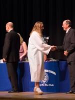 Kristi accepts award