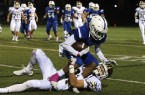 AlgonquinÕs Chris Skinner drags down LeominsterÕs Allen Link during FridayÕs game at Doyle Field. 	SENTINEL & ENTERPRISE / SCOTT LAPRADE