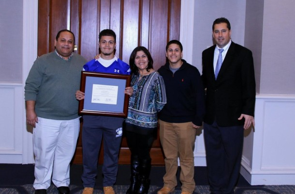 Angel with family and Head Coach Dave Palazzi