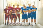 From left, FitchburgÕs Michael Nowd, Kyle Koutonen, CJ Byars and Alex Marrero and LeominsterÕs Anthony Dandini, Angel Colina, Noah Gray and Austin MacDonald stand in the tunnel leading to Doyle Field, site of todayÕs annual Thankgiving Day game between the two schools.            SENTINEL&ENTERPRISE/Ashley Green