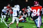Fitchburg's Jason Corbeil breaks through the defense before scoring a touchdown during the Pigeon Bowl against the Leominster freshmen on Friday, November 17, 2017. SENTINEL & ENTERPRISE / Ashley Green