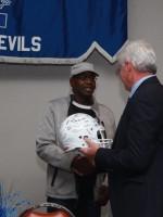 John Austin presented signed helmet
